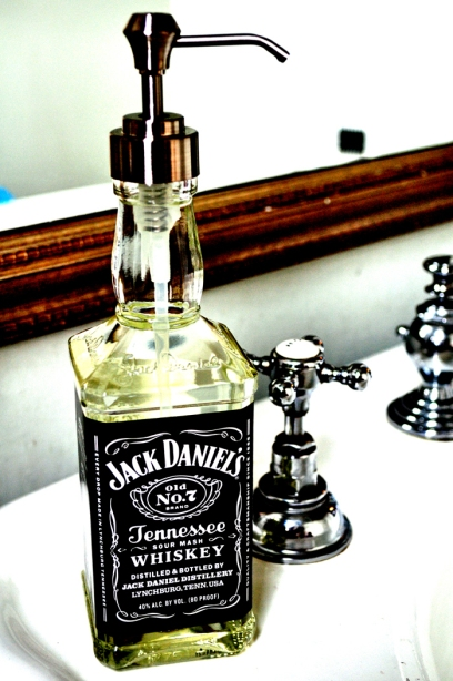 beautiful soap dispenser!  check out the original post!:) http://curlybirds.typepad.com/curly-birds/2012/12/quick-gift-jack-daniels-soap-dispenser-.html